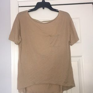 Open back tan t-shirt with suede braid accents